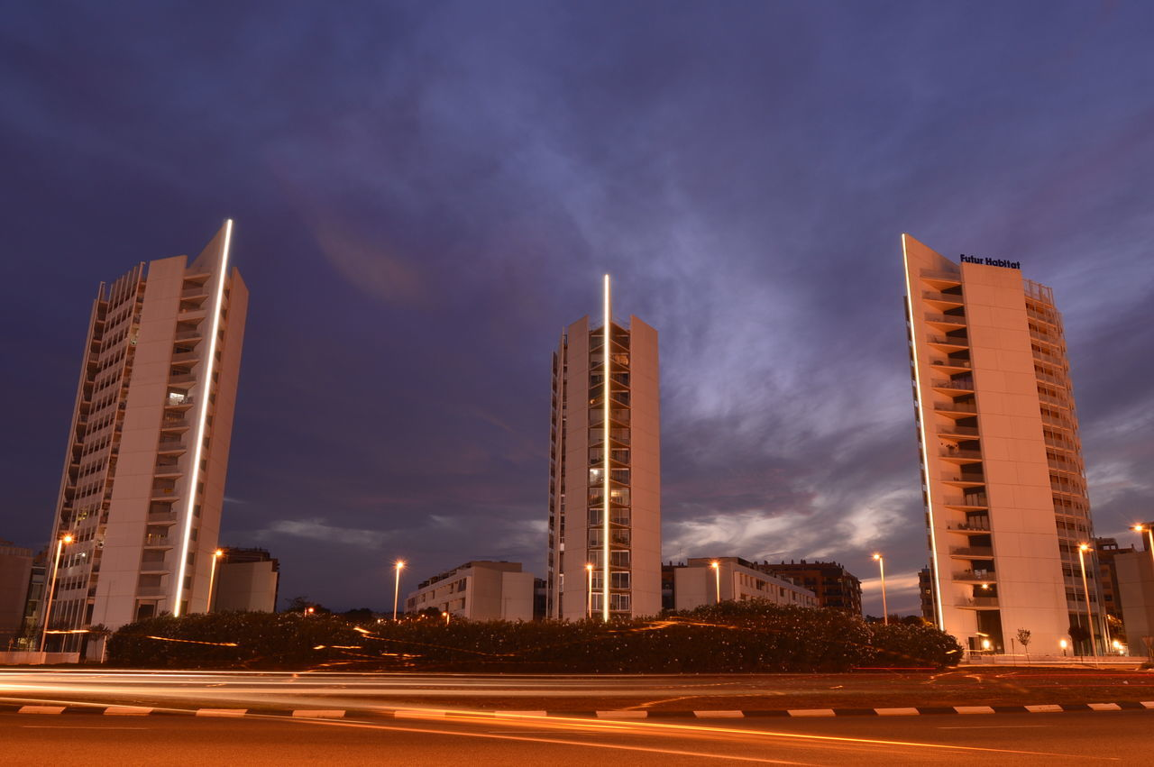 architecture, building exterior, sky, built structure, outdoors, street light, illuminated, road, skyscraper, no people, city, night