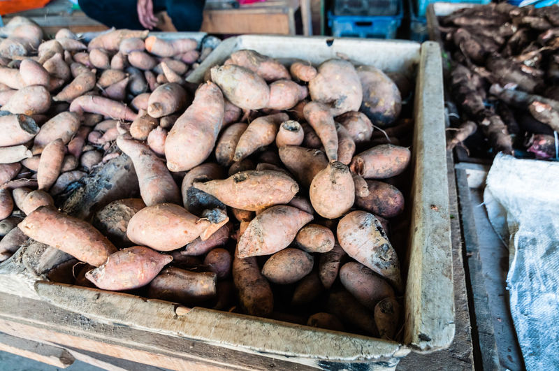 Stack of sweet potatoes for sale at market stall