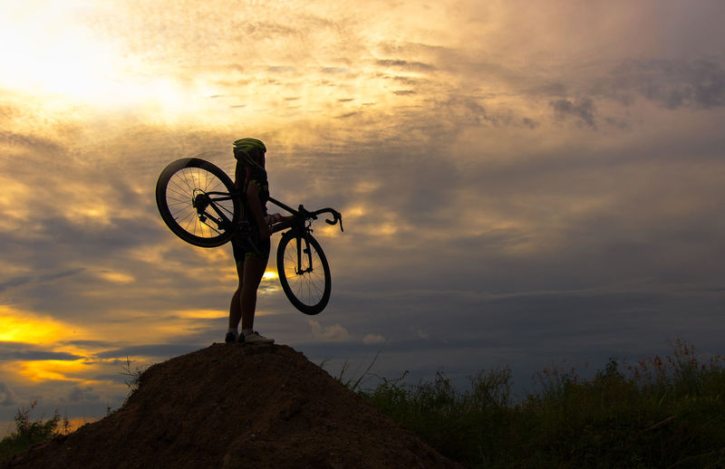 Low angle view of silhouette bicycle against sky during sunset