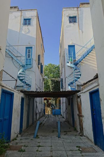 Architecture Blue Building Exterior Built Structure Clear Sky Day House Low Angle View No People Outdoors Residential Building Sky Symmetrical, Stair Case, Spiral, Blue, Greek, Greece, Street, Back Alley
