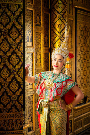 Art culture Thailand Dancing in masked khon in literature ramayana,Thai classical monkey masked, Khon,Thailand One Person Beauty Young Adult Beautiful Woman Indoors  Pattern Fashion Young Women Elégance Adult Clothing Ornate Women Beautiful People Architecture Females Standing Traditional Clothing Floral Pattern Hairstyle Luxury Architectural Column