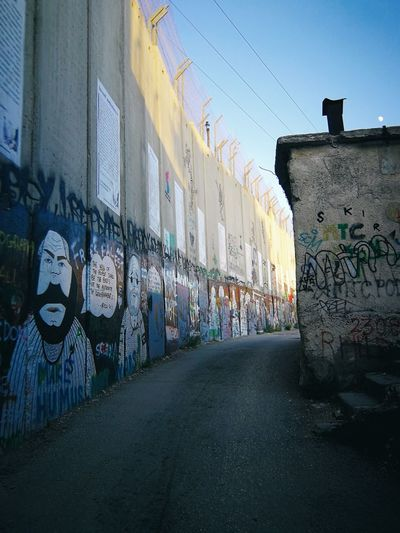 Visiting Palestine... Banksy Palestine Palestina Palastina West Bank Jerusalem Israel Conflict Zone Street Art Graffiti Art And Craft Architecture Building Exterior Built Structure Spray Paint Modern Art Aerosol Can Wall - Building Feature