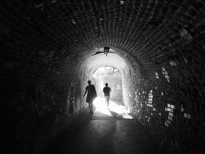 Arch Real People Architecture Silhouette Tunnel Lifestyles Leisure Activity Built Structure Men Illuminated Full Length The Way Forward Nature Togetherness Two People People Direction Standing Tree Outdoors