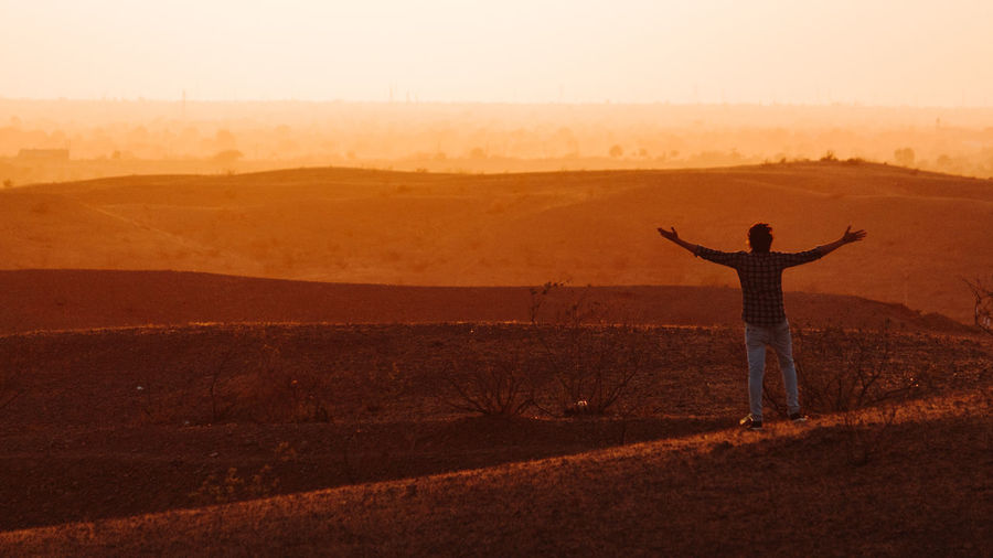 Human Arm One Person Landscape Standing Land Rear View Environment Real People Field Leisure Activity Lifestyles Limb Sky Scenics - Nature Arms Raised Tranquility Freedom Nature Tranquil Scene Arms Outstretched Outdoors Positive Emotion