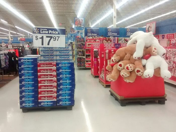 a stack of beer and TeddyBears face down in a heap... Is this a Teddybeer thing, or a comment on valentines day by Walmart employees?