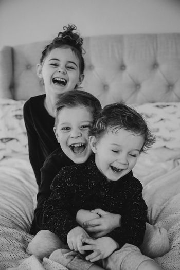 Trio Togetherness Childhood Indoors  Baby Family Child Love Home Interior Happiness Family With One Child Smiling Domestic Life Bonding Mid Adult Lifestyles Bed Fun Cute Leisure Activity Toddler