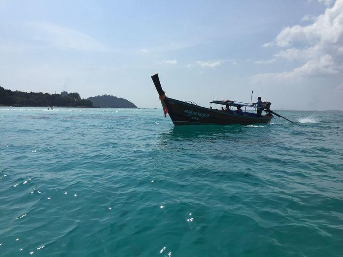 Boat in sea against sky