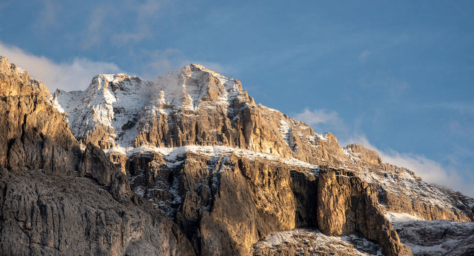 Mountain landscape with dolomite rocky peak covered with snow in the alps of south tyrol in italy