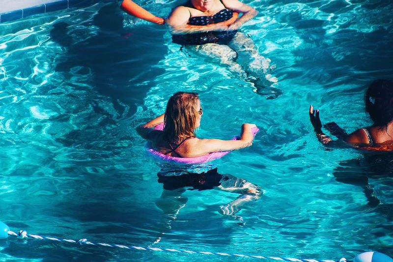 Pool day Water Pool Swimming Pool Swimming Leisure Activity Lifestyles Real People Two People High Angle View Men Nature Adult Child Turquoise Colored Women Day Enjoyment Outdoors People Exploring Fun