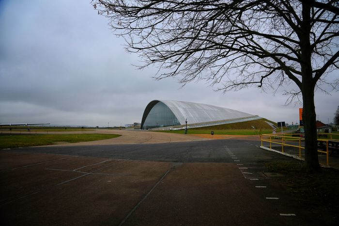 Duxford Imperial War Museum Aerial Architecture Bare Tree Built Structure Combat Plane# Concorde Concorde Plane Day Duxford Imperial War Museum F22 Raptor Mig21 Nature No People Outdoors Plane Museum Planes Sky Stealth Transportation Transportation Tree Weather
