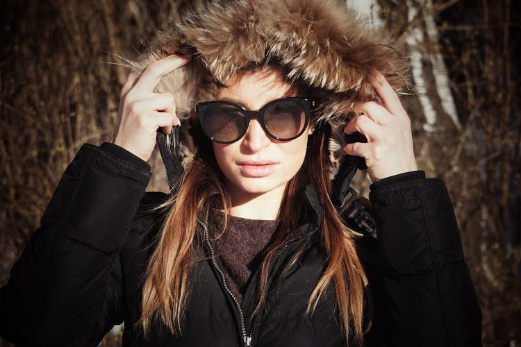 Portrait of woman wearing sunglasses outdoors