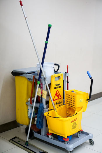 Cleaning equipment against wall