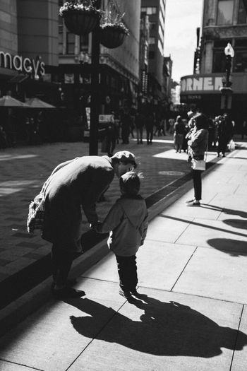The Street Photographer - 2017 EyeEm Awards Streetphotography Mother And Son Boy Childhood Child Parenthood Parent City Life Street Boston Real People Still Life