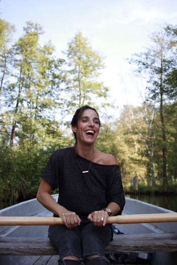 Beautiful Woman Happiness Smiling Sitting One Person Tree Happiness Outdoors Day Casual Clothing Front View Leisure Activity Mature Adult Cheerful Enjoyment Lifestyles Nature Real People Portrait Sky Adult Adults Only Rowboat Rowing