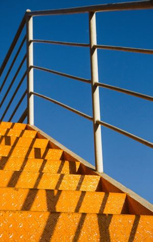 Stairs And Sky Color Contrast Clear Sky Blue And Orange Colors And Patterns
