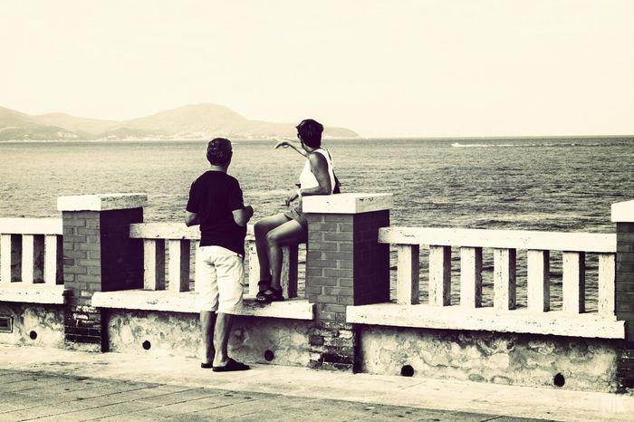 """My love, look Elba Island"" - Piombino, Italy Streetphotography Landscape_photography Couple Italy"