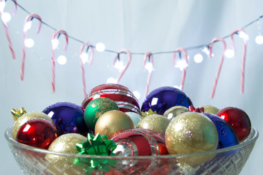 Bowl of decorations Bauble Celebration Celebration Event Christmas Christmas Decoration Christmas Lights Christmas Ornament Close-up Cultures Day Decoration Food Gift Holiday - Event Illuminated Indoors  Multi Colored No People Table Tradition