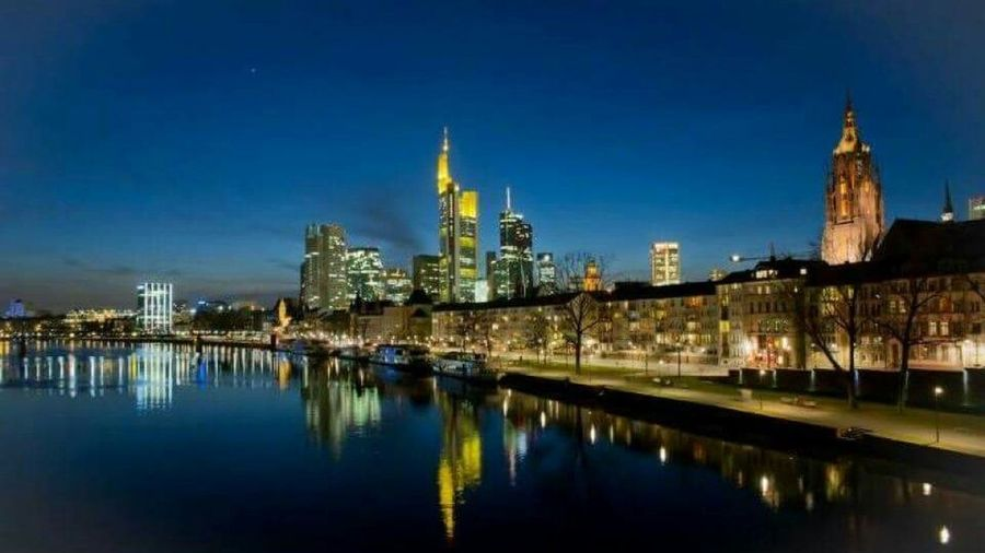 Reflection Politics And Government City Architecture Dusk Travel Destinations Government Cityscape Tower Night Arrival Urban Skyline Place Of Worship Building Exterior Illuminated Business Finance And Industry No People Sky Waterfront Water Frankfurt Am Main Mainhatten