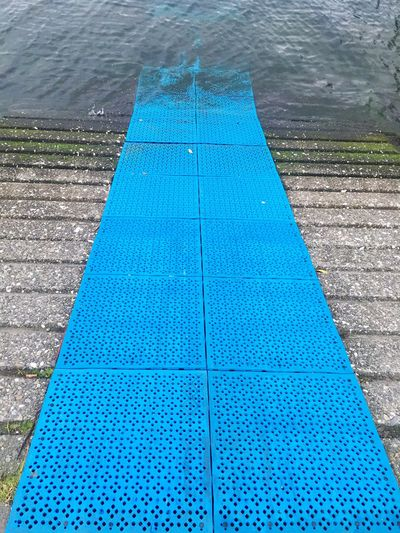 The blue rubber leading down the ramp to the lagoon Blue Rubber Ramp Boat Ramp Non Slip Lagoon