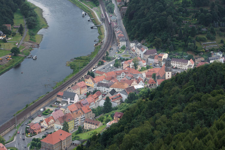 High angle view of houses and river in town