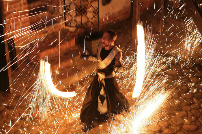 Blurred Motion Burning Danger Factory Fire - Natural Phenomenon Flame Full Length Glowing Heat - Temperature Illuminated Indoors  Long Exposure Men Motion Night Occupation One Person Protection Protective Workwear Real People Skill  Sparkler Sparks Wire Wool