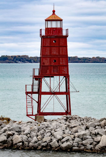 Racine Pierhead Light Racine Wisconsin Architecture Beauty In Nature Built Structure Cloud - Sky Day Lighthouse Lookout Tower Nature No People Outdoors Pierhead Red Rock - Object Safety Scenics Sea Sky Tower Tranquil Scene Tranquility Travel Destinations Water