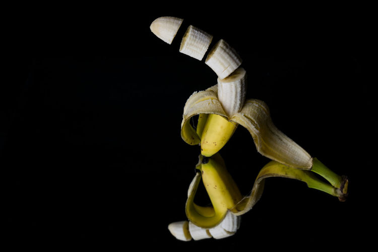 Banana Banana Peel Black Background Close-up Food Food And Drink Freshness Fruit Healthy Eating Mirror Mirror Reflection Mirrored No People Peeled Sliced Sliced Fruit Studio Shot Yellow Art Is Everywhere