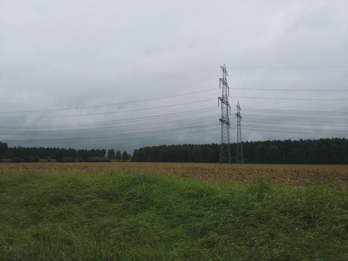Northern Germany. · Germany Norddeutschland Tiefebene Flat Fields Plains Utility Pole Utilities Electricity  Nature Rural Scene Rural Landscape Gray Sky Sky And Clouds