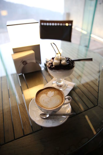 High Angle View Of Coffee Cup On Glass Table At Home