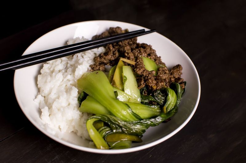 Rice and beef bowl Traditional Beef Chopsticks Rice - Food Staple Food And Drink Food Freshness Ready-to-eat Healthy Eating No People Indoors  Bowl Plate Serving Size Vegetable Close-up Table Black Background Day Food Stories Food Stories