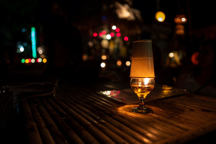 Koh Lipe Illuminated Night Table Glass No People Focus On Foreground Food And Drink Refreshment Alcohol Drink City Drinking Glass Wood - Material Bar - Drink Establishment Business Restaurant Household Equipment Wineglass Nature Empty Nightlife Bar Counter