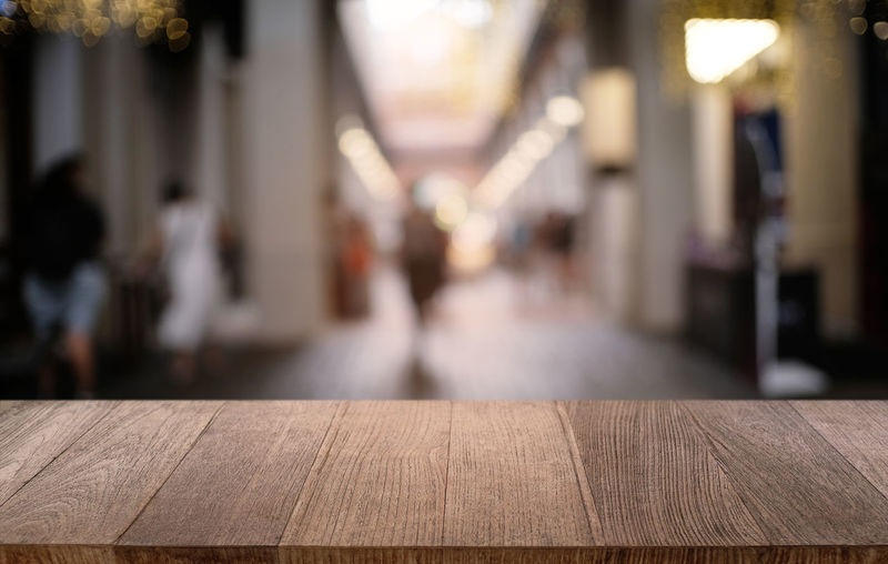 Close-up of bench on table against building