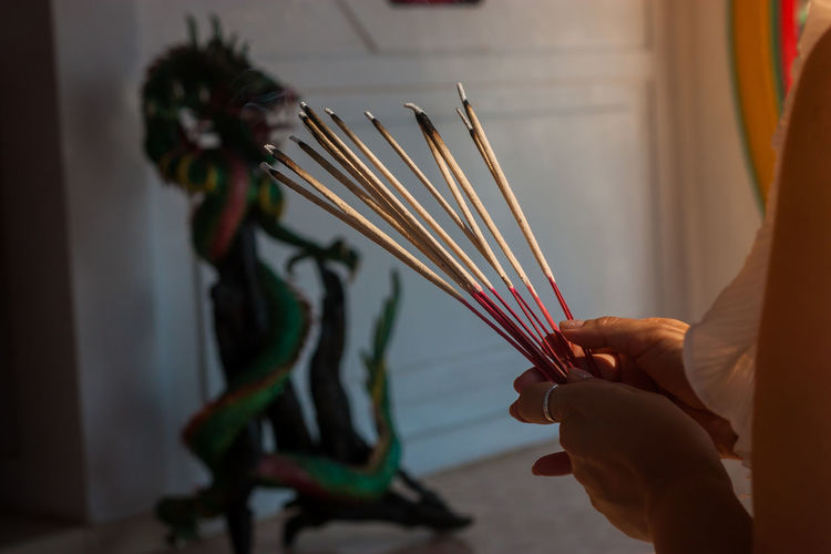 Belief Hand Holding Incense Indoors  Lifestyles Real People Religion Spirituality