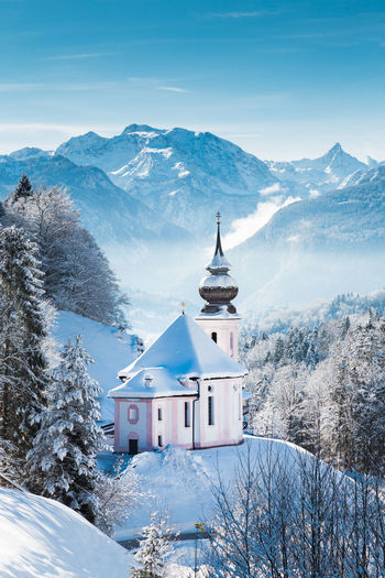 Snow covered maria gern church on mountain