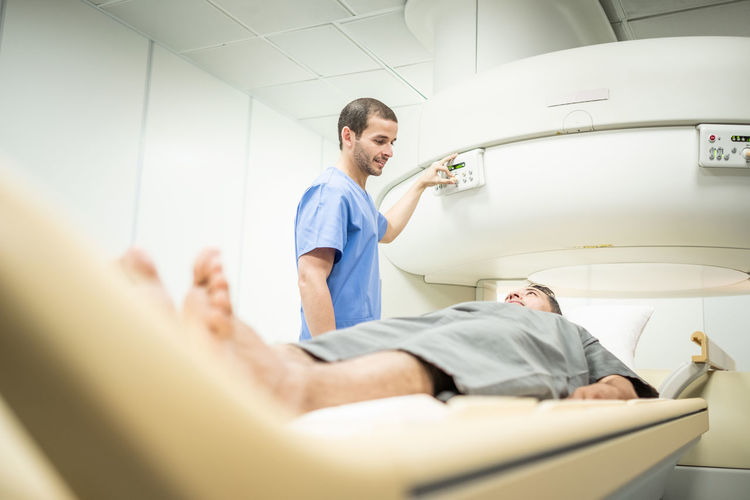 Full length of a man lying down for mri scan