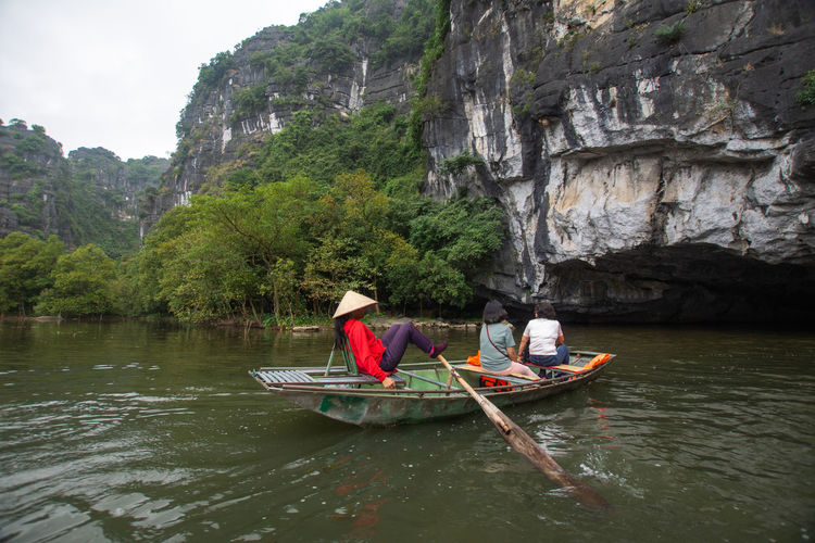 Tam Coc, Vietnam Nautical Vessel Water Transportation Real People Mode Of Transportation Waterfront Leisure Activity Day Nature People Tree Oar Lifestyles Men Beauty In Nature Rock Sitting River Women Outdoors Tam Coc Vietnam Travel