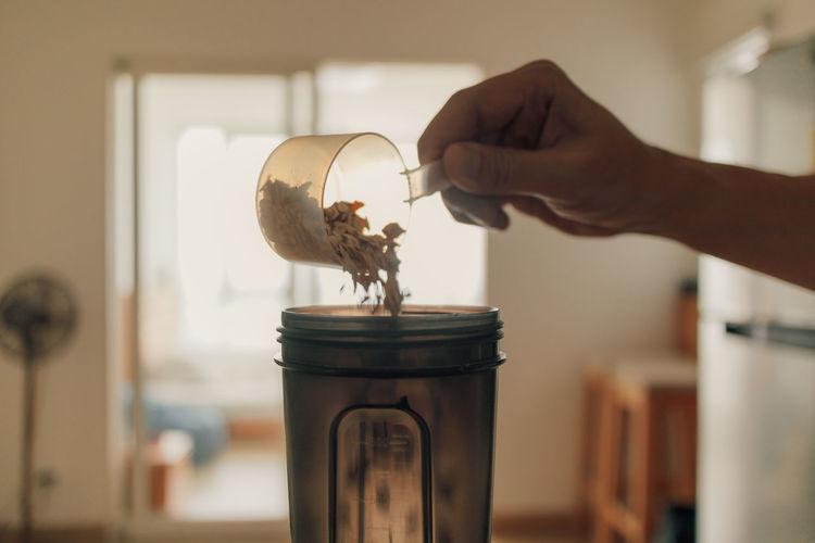 Close-up of hand holding jar