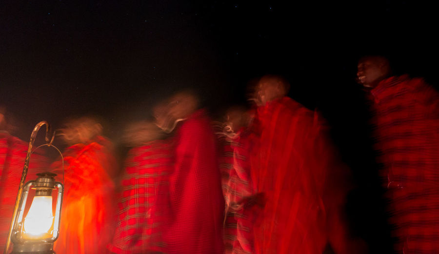 Blurred motion of people at night