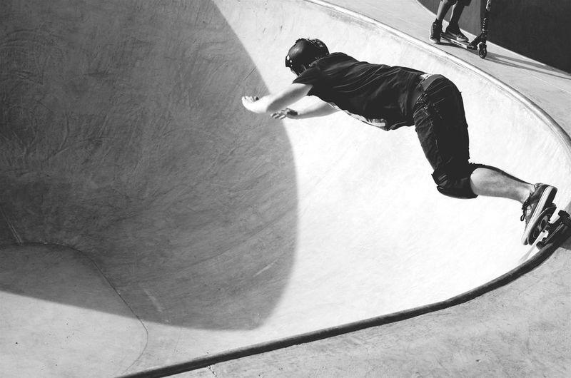 Full Length Side View Of Skateboarding