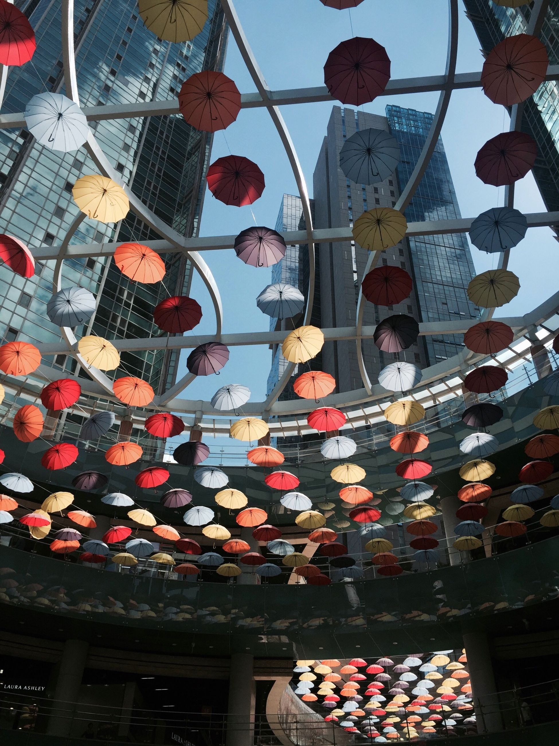 low angle view, hanging, architecture, built structure, decoration, tradition, lantern, cultures, building exterior, celebration, multi colored, religion, art and craft, art, spirituality, creativity, sky, day, lighting equipment, indoors