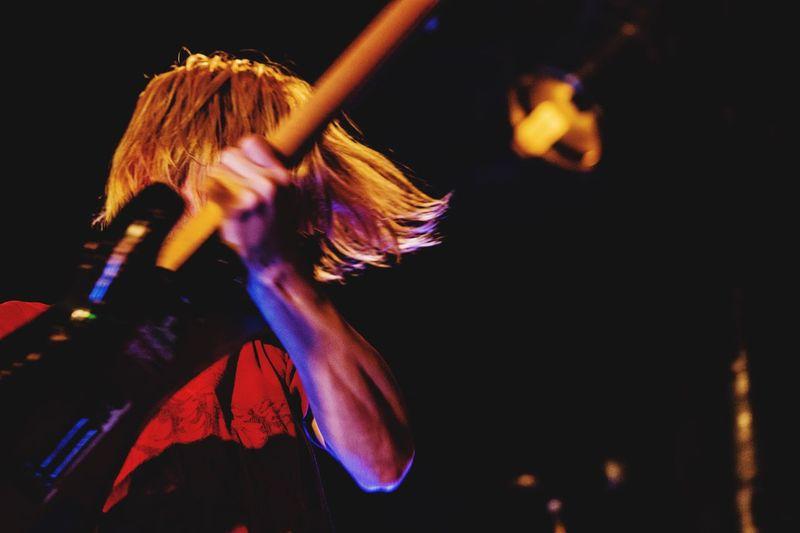 Close-Up Of Man Playing Guitar At Concert