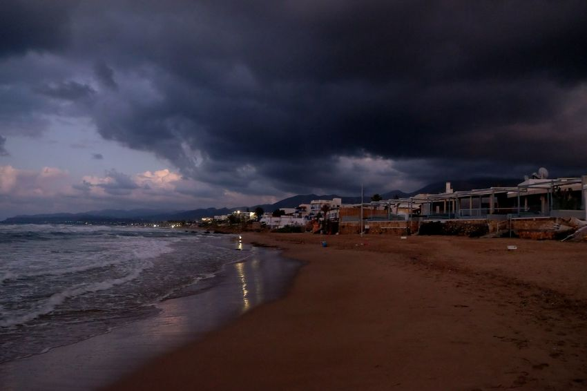 EyeEm Selects Sea Beach Dramatic Sky Cloud - Sky Water Landscape Storm No People Horizon Over Water Thunderstorm Building Exterior Storm Cloud Power In Nature Sky Nature Travel Destinations Night Outdoors Vacations Sand Photographer Photooftheday Lights Watercolor