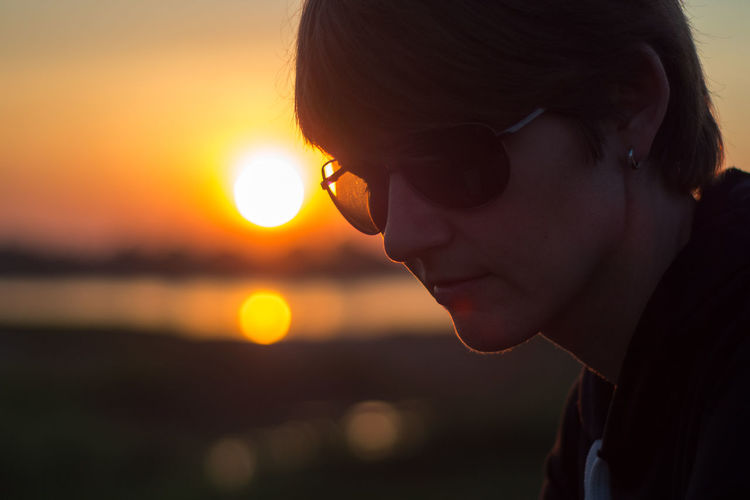 Contemplation Fashion Focus On Foreground Glasses Headshot Human Face Land Laos Leisure Activity Lifestyles Looking Nature One Person Outdoors Portrait Profile View Real People Side View Sky Sun Sunglasses Sunset Teenager Water Young Adult