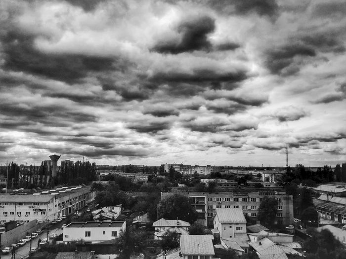 View of town against cloudy sky