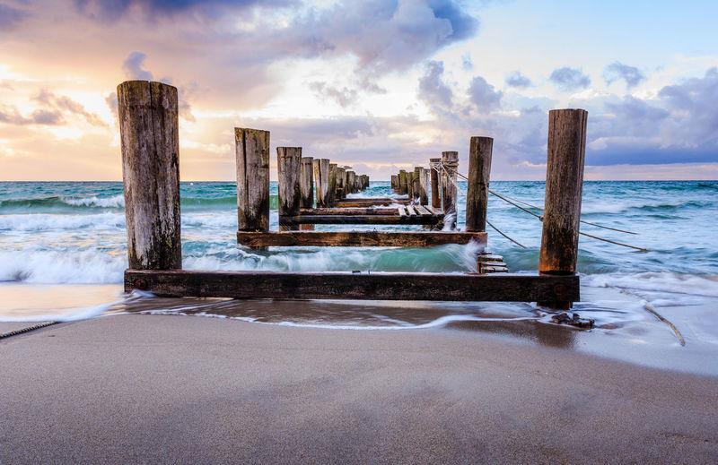 Broken Pier On Sea