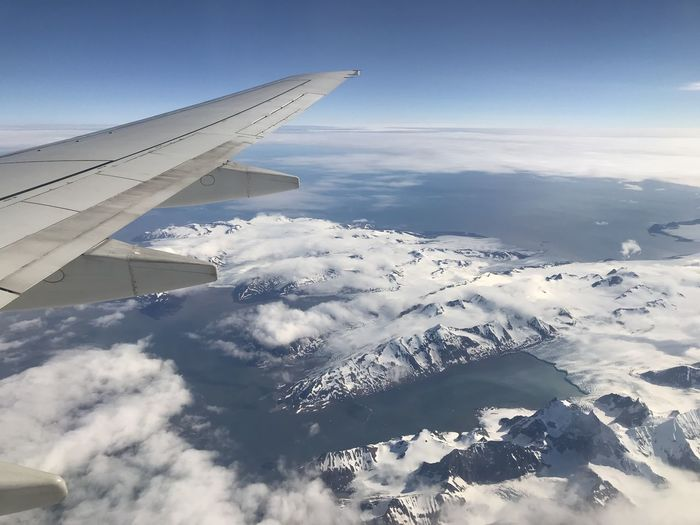 Above Aerial View Air Vehicle Aircraft Wing Airplane Beauty In Nature Cloud - Sky Cold Temperature Environment Flying Mode Of Transportation Mountain Mountain Range Nature No People Outdoors Scenics - Nature Sky Snow Snowcapped Mountain Transportation Travel Winter