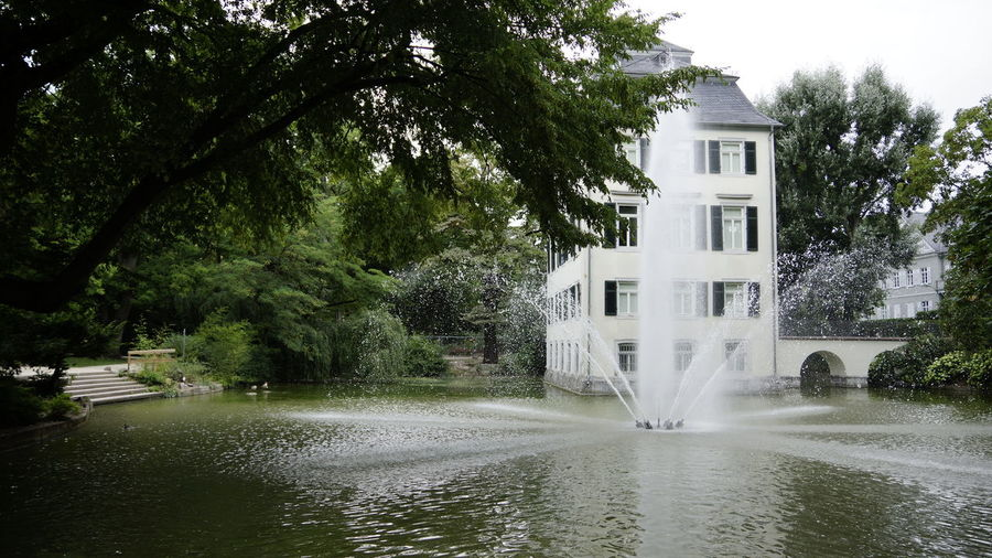 Tree Water Plant Architecture Built Structure Building Exterior Nature Waterfront Building Growth Motion Day House No People Lake Beauty In Nature Outdoors Residential District Long Exposure Spraying Flowing Water Flowing Popular Places