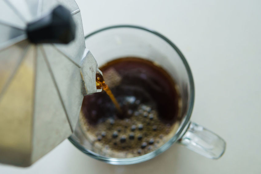 pouring coffee Black Coffee Close-up Day Drinking Food And Drink Freshness Glass Cup High Angle View Indoors  Moka Pot No People Pouring Coffee Table