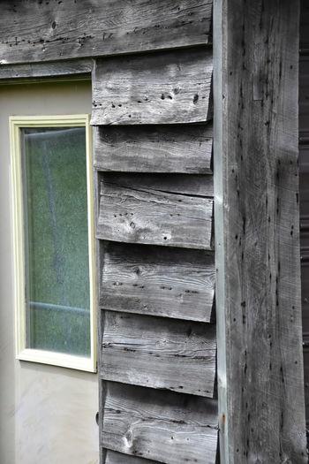 Close-up of old wooden door of building