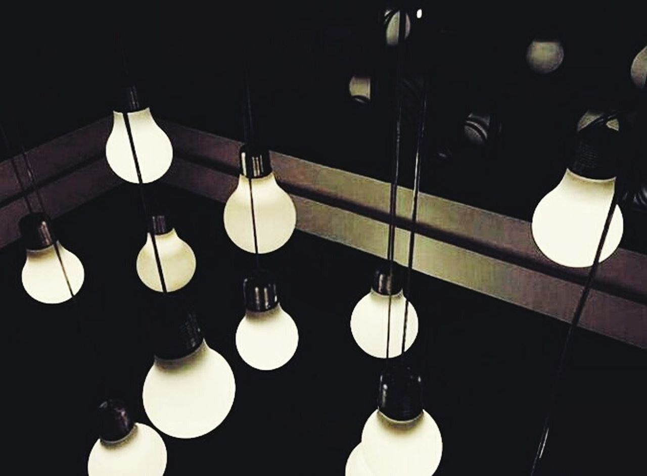 lighting equipment, hanging, illuminated, in a row, electricity, electric light, electric lamp, indoors, light bulb, no people, low angle view, modern, close-up